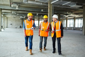 three contractors talking about mechanics lien as they walk
