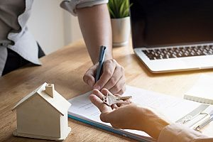 a Northern Virginia title company helping a homebuyer sign their contract
