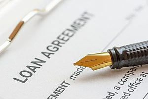a home loan agreement being refinanced with the help of a Sterling, VA title company