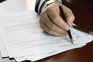 a title insurance policy being signed by a home buyer