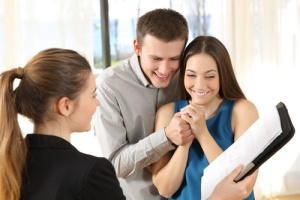 Couple with Title Insurance Lady
