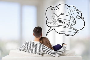 a couple dreaming about their new home during the home buying process