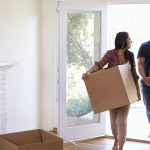 a couple moving into their new home after going through the home buying process