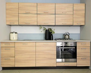 Light wood cabinets in modern kitchen