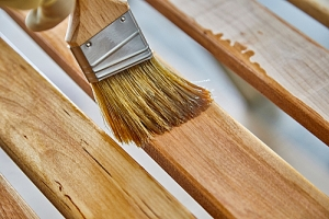 Repainting wooden slats on furniture to make it look new