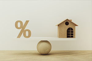 Percentage symbol icon and house scale in equal position.