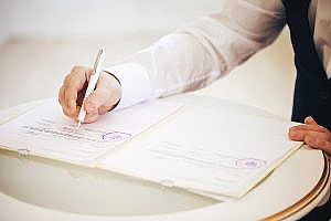 a title agent signing important legal documents