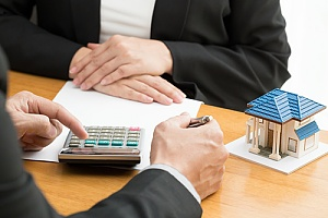 Real estate agent showing loan paperwork