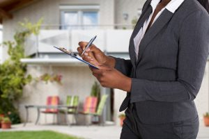 Woman conducting a home appraisal