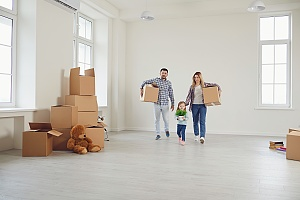 family walking into  new home after knowing home being sold after finding out what Is A Purchase Agreement