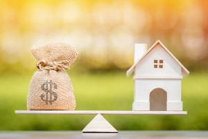 home and a Refinancing  Mortgage on a balance scale