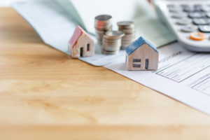 person wondering what questions to ask when buying a foreclosure