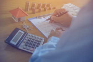 man finding out title insurance cost calculated at work