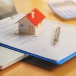 home looking for title insurance on a desk