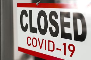 Closure sign on retail store window. Negative interest rates generally appear during major recessions