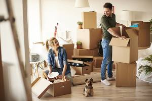 Couple moving into a new home. Homeowners will refinance their home loan for many different reasons