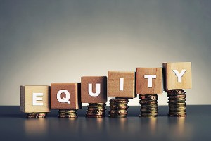 Equity written on wooden block. Refinancing to tap equity