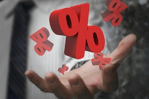 Hand showing red percentage signs. Negative interest rates concept