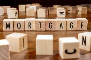 Mortgage written on wooden blocks. Concept image for fixed rate mortgage