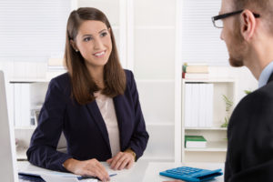 client meets with insurance agent to talk more about the title insurance claim