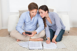 couple are calculating the cost and How To Get Rid Of PMI