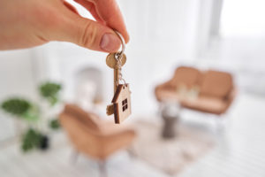 homebuyer holds key to new home after reaching commitment to buy house and the title insurance