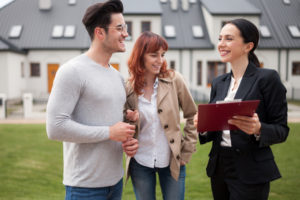 realtor explains private mortgage insurance to couple after showing them the house