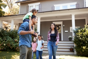 family in their new house after they both learned title insurance terms