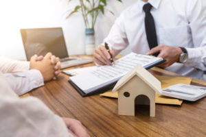 broker explains the title insurance policy to the homeowners