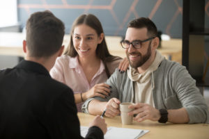 couple meets with insurance broker to discuss their owners title insurance plan