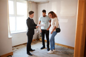 realtor explains the owners title insurance policy to the homebuyers