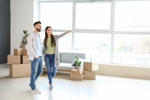 young couple using Real Estate Settlement Services