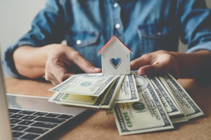 money being changed for a home for Refinancing A Home