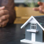 broker explains to homeowner how lender's title insurance is calculated in the down payment of home