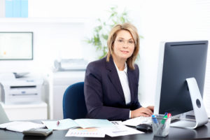 consultant uses desktop to do property title search for a client