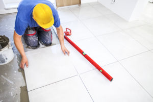 contractor puts the tile in place after coming to an agreement with homeowner on the mechanics lien