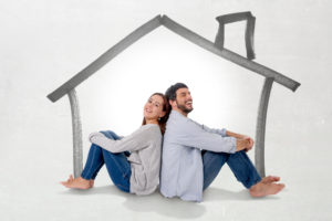 couple sitting with back against each other contemplate about buying a home in northern virginia