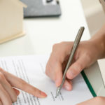 mortgage broker directs the homeowner on what to sign on the document