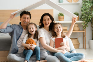 new homeowners hold the bent board above them after securing how long does title insurance last