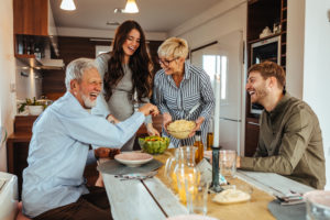 real estate settlement company helped the smiling homebuyers buy their home