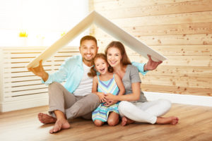 the family with the folded board over them used the services of a real estate settlement company to buy their home