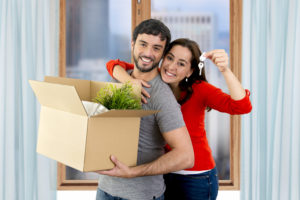 the first time home buyers smile as they move into their new home