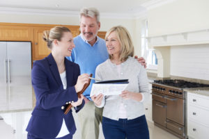the realtor explain the floor plan to the first time home buyers