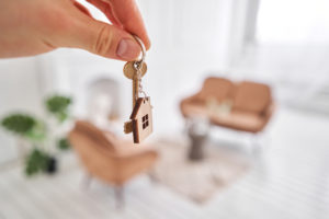 with help of a real estate settlement company homeowner was able to get key to new home