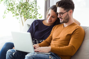 homebuyers use laptop to find more information on a title company