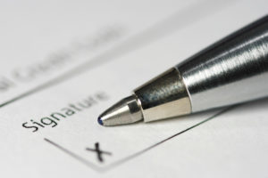upclose view of a signature line on a title company contract