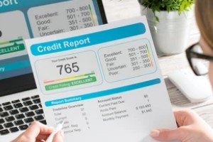 Person Looking at Credit Report after knowing mechanic's lien