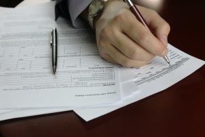 person signing a form for title company