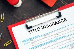 owner's title insurance on paper with red cardboard