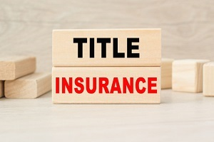 title insurance is written on a wooden cubes structure for lenders title insurance